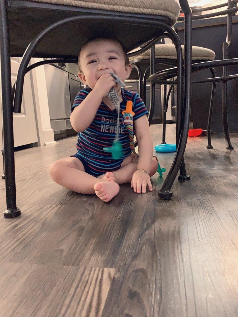 now that he's crawling, his favorite spot is under the dining table chairs <br>http://pic.twitter.com/E2mmOEv0Ji