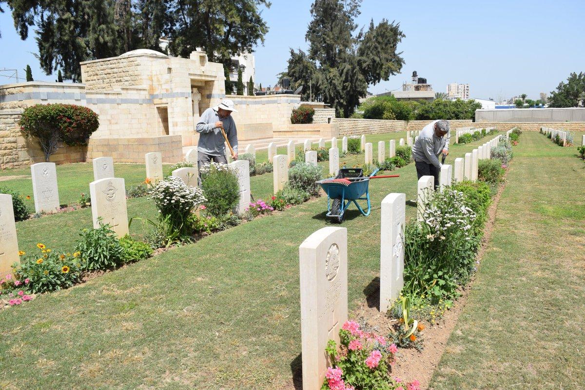 Staff working hard at @CWGC Gaza War Cemetery. #LestWeForget #WeAreCWGC @Bennett22David<br>http://pic.twitter.com/QBJXh6nalT