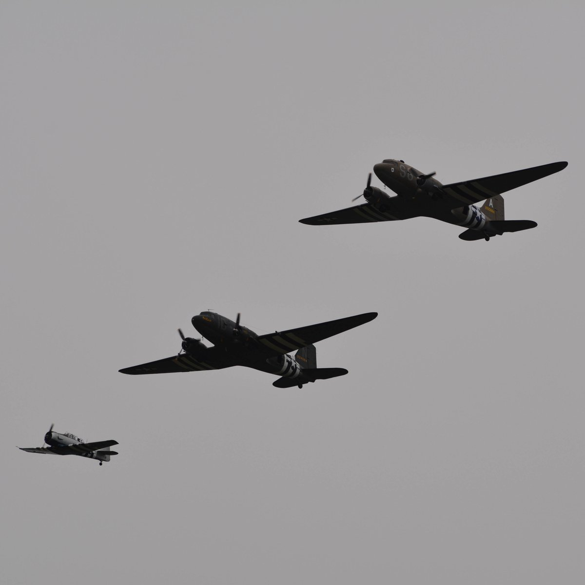 """A Harvard & two Douglas C-47 Dakotas: """"Placid Lassie"""" & """"Aces High"""" from the Daks Over Normandy Memorial Flight over Beachy Head on June 5th.   More photos here https://emcforcescars.com/daks-over-normandy-memorial-flight-75th-anniversary-of-d-day/…   #DAKSoverNormandy #DDay75thAnniversary #DDay #WWII #History #BeachyHead #C47"""