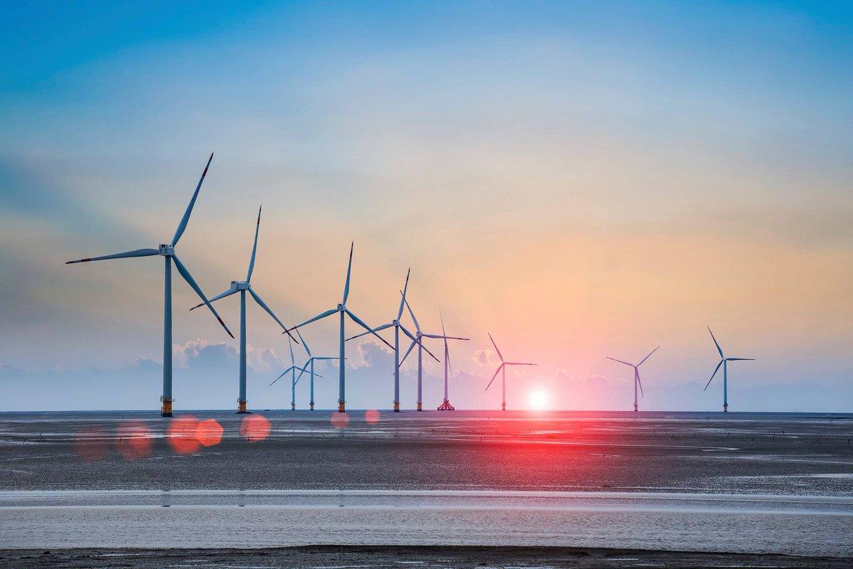 windturbines on the horizon at sunset