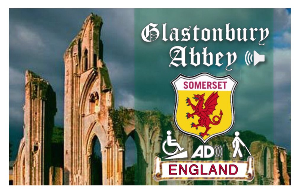 On the front wall at the west side of the abbey where the grand entrance was the ruins are in Cotswold stone and imposing site against a great deal sky Glastonbury Abbey Somerset England visually impaired audio wheelchair access