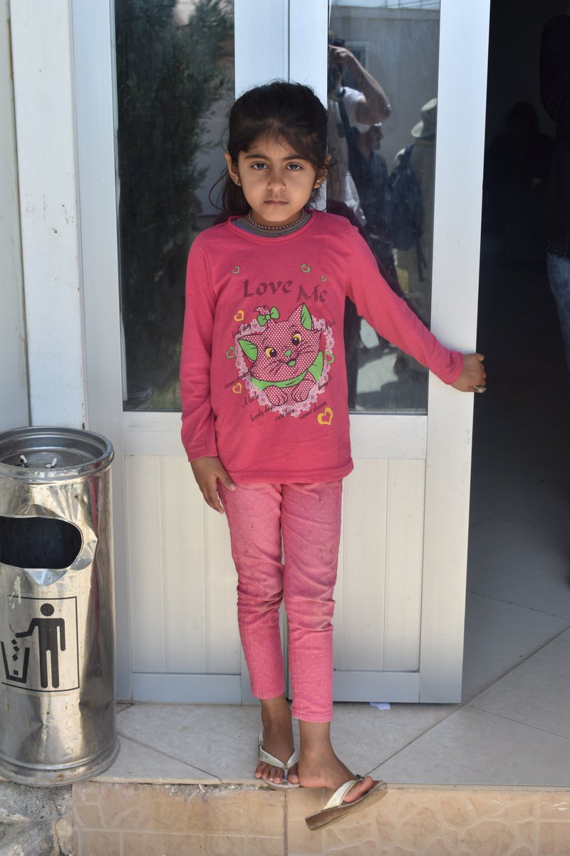 test Twitter Media - This little girl stands outside our healthcare clinic in Khanke camp #Iraq. In May 35% of the patients we treated were under the age of 14. We also run a kindergarten to try to provide children who have been displaced with as much continuity in education as possible. #Yazidi https://t.co/pkhxdMV2Cm