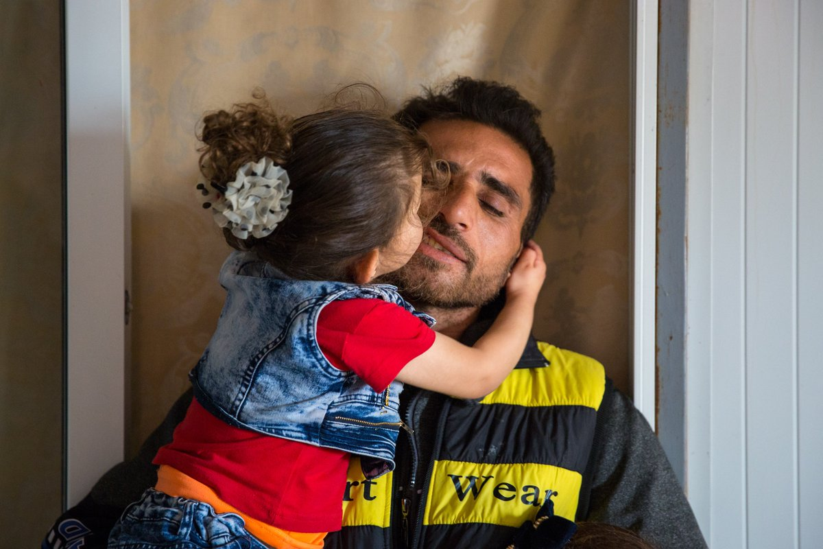 Tomorrow is #WorldRefugeeDay. We're proud to stand #WithRefugees and their families 🤝  Just like Khalid & his daughter. Meet them → http://bit.ly/Refugee_Family 📸 @rosiethomp