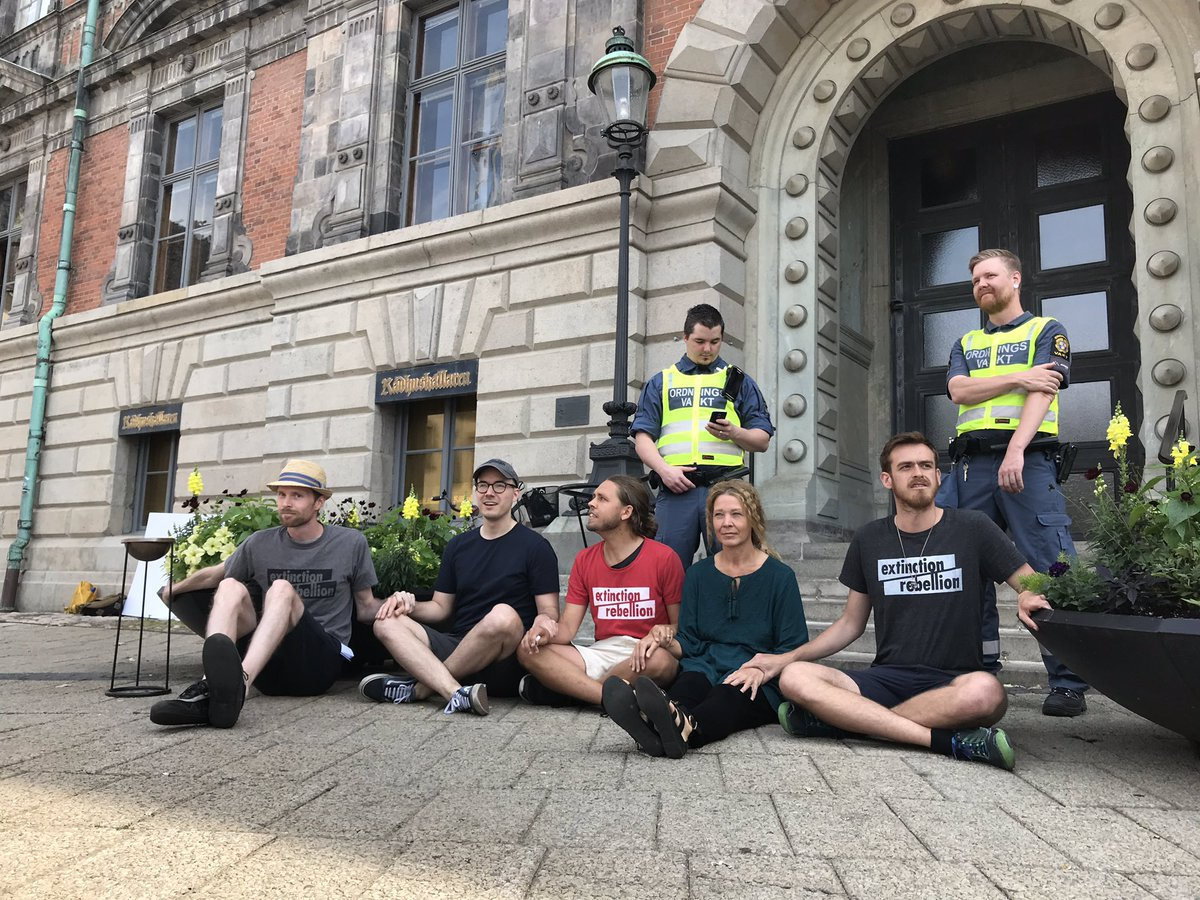 Glued in place outside Malmö city hall ahead of council meeting. We demand that Malmö declares a climate emergency