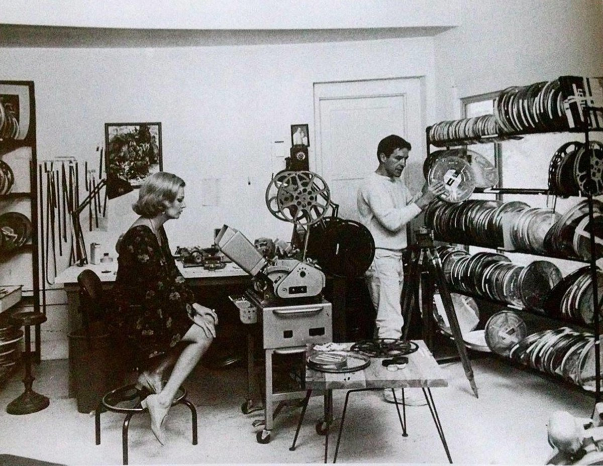 Gena Rowlands and John Cassavetes in the editing room (garage) of their Hollywood Hills home, 1967.