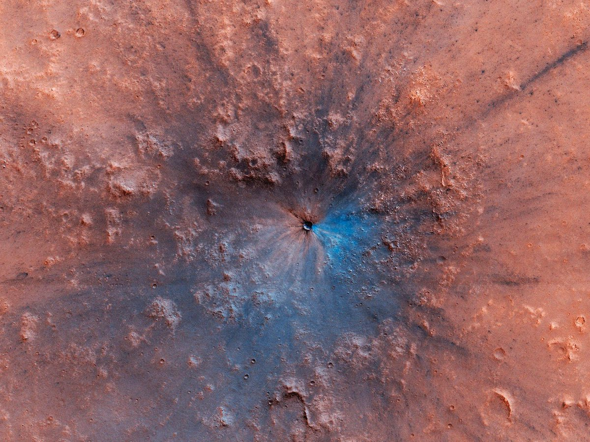 Art or Mars? Both! This new impact crater on the Red Planet reveals darker material beneath reddish dust. Read more about what lies beneath: go.nasa.gov/2XnO94v