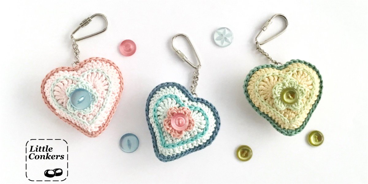 Hand-crocheted heart key fobs featuring vintage buttons from my stash.  http://littleconkers.co.uk/heart-key-fobs/