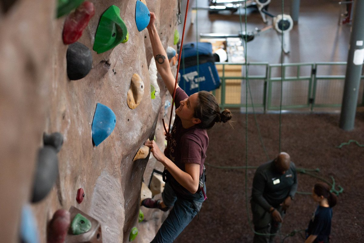 [Image Description: Member ascending up the Climbing and Bouldering Wall.]