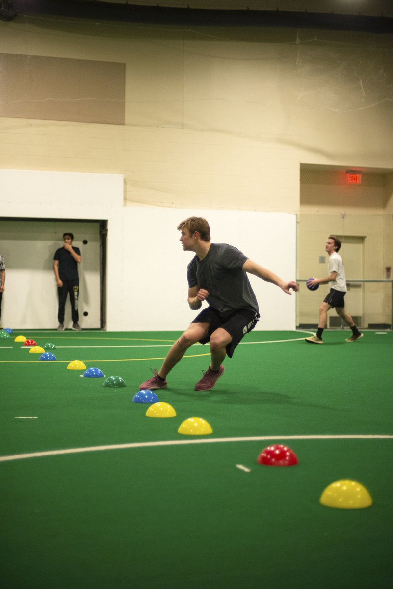 [Image Description: Members playing dodgeball in the Multi-Activity Center.]