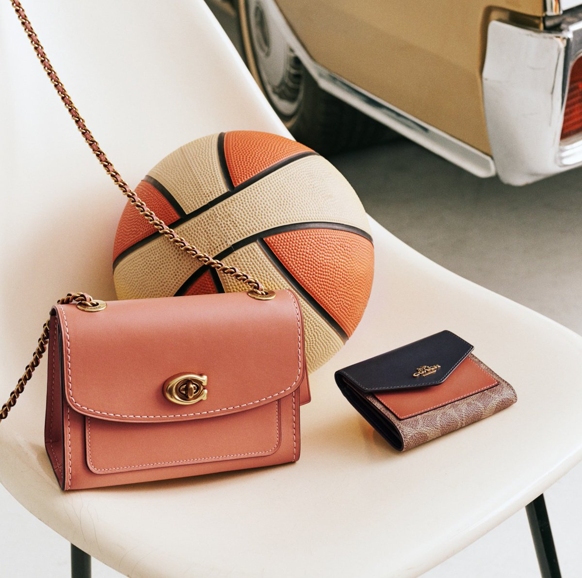 Alley-oop! The Parker 18 Shoulder Bag and a colorblock wallet make a winning team for summer color. http://on.coach.com/SignatureStyle #CoachNY