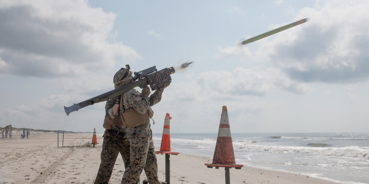 Launch Party Staff Sgt. John Hawkins, left, assists Sgt. Joshua C. Sutton fire a FIM-92 Stinger missile at his target at Onslow Beach, North Carolina.
