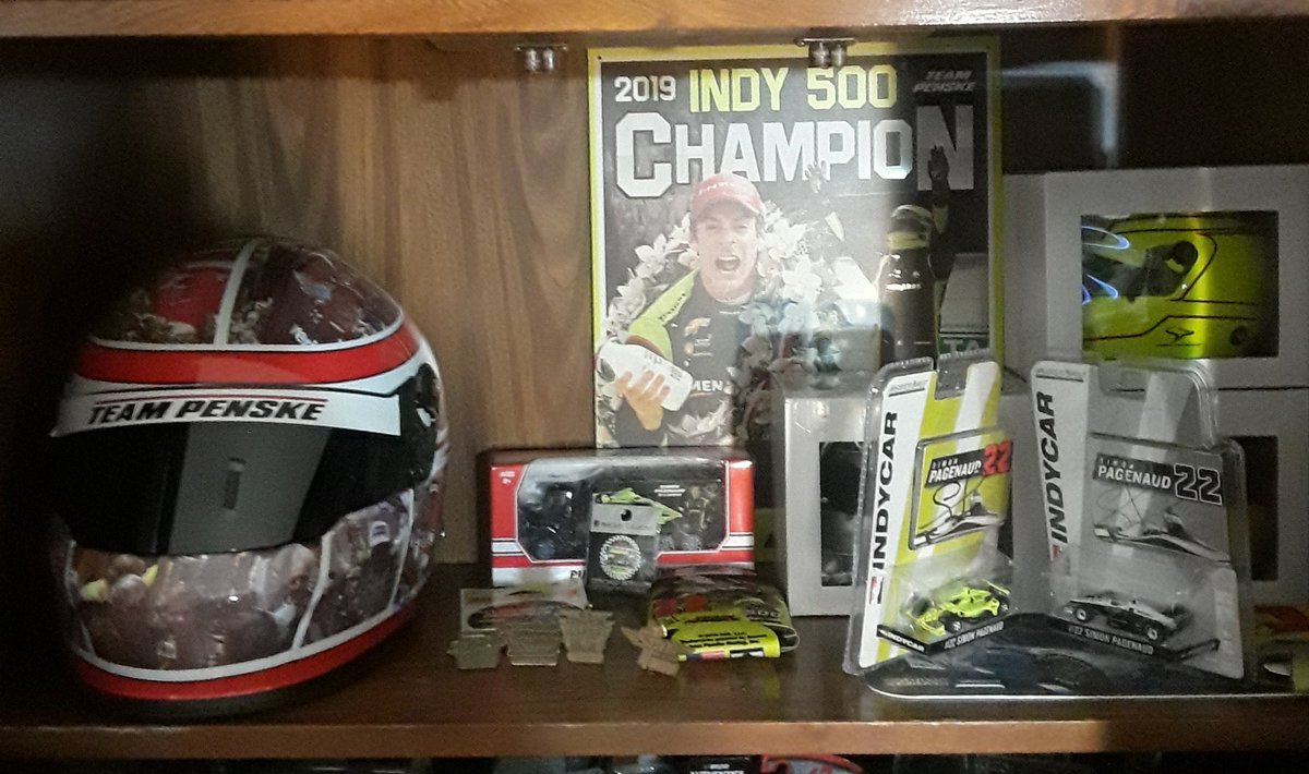 My @simonpagenaud shelf is starting to take shape. It will probably change 57 times and trust me this isnt complete yet.  #indycar #indy500 #winnersdrinkmilk #penske