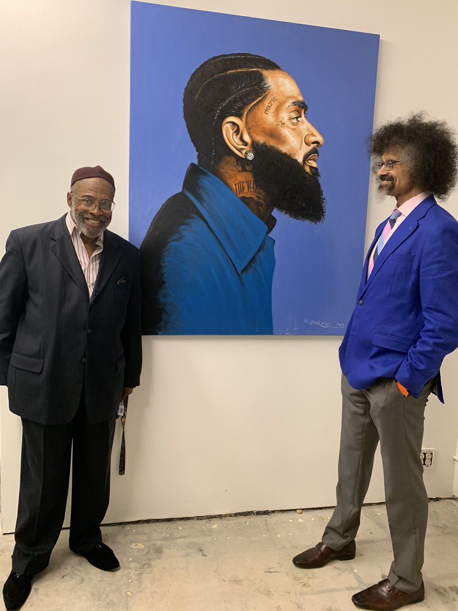 Two different artists, a painter and a photographer, each standing next to their respective portraits of Nipsey Hussle. These Nipsey portraits perfectly captured the Art & Justice spirit of tonight's Juneteenth celebration at Umoja in Leimert Part, black L.A.'s cultural hub.