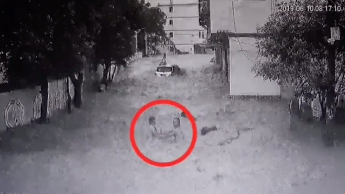 Watch: Man rescues two kids from flood in fewer than two minutes