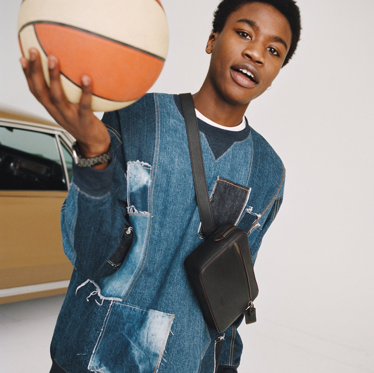 Got Game? Our Denim Patchwork Sweatshirt makes a sporty staple feel one-of-a-kind. http://on.coach.com/MenStyle #CoachNY