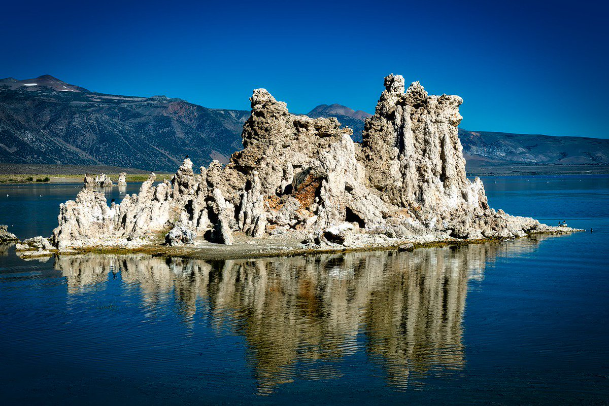 The moment you see Mono Lake in person you'll believe you're on another planet. Snowcapped mountains surround this salty blue #lake that has plenty of Tufa, columns of limestone that have been formed by the salinity of the water. #California http://www.ticketsnfares.com #MonoLake