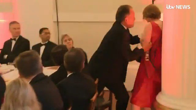 In this longer version of the video, you can see the woman apparently posing no immediate threat as she passes behind Mark Field. He marches her out of the room by her neck. I wasn't there, so I can't say she didn't pose a risk, but it looks heavy handed.