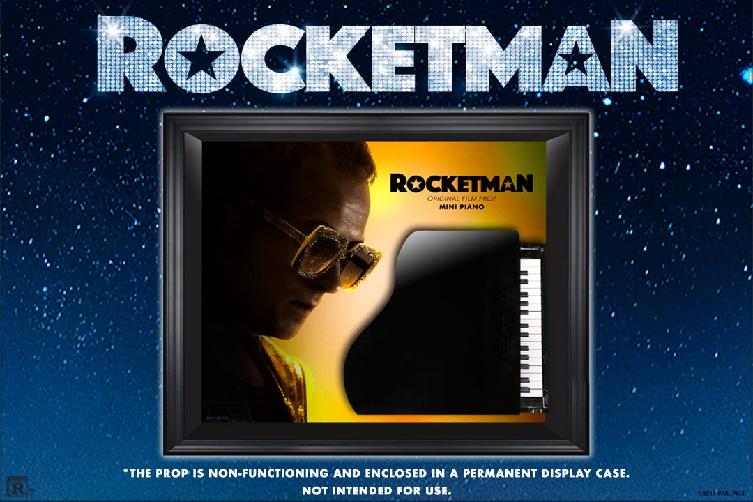 Where are the #Rocketman fans at? We are excited to give away a framed prop from the film! FOLLOW our page & LIKE this post to be entered to win a small baby grand piano.  🤩🎹  *This is a non-functioning piano & is enclosed in a display case*
