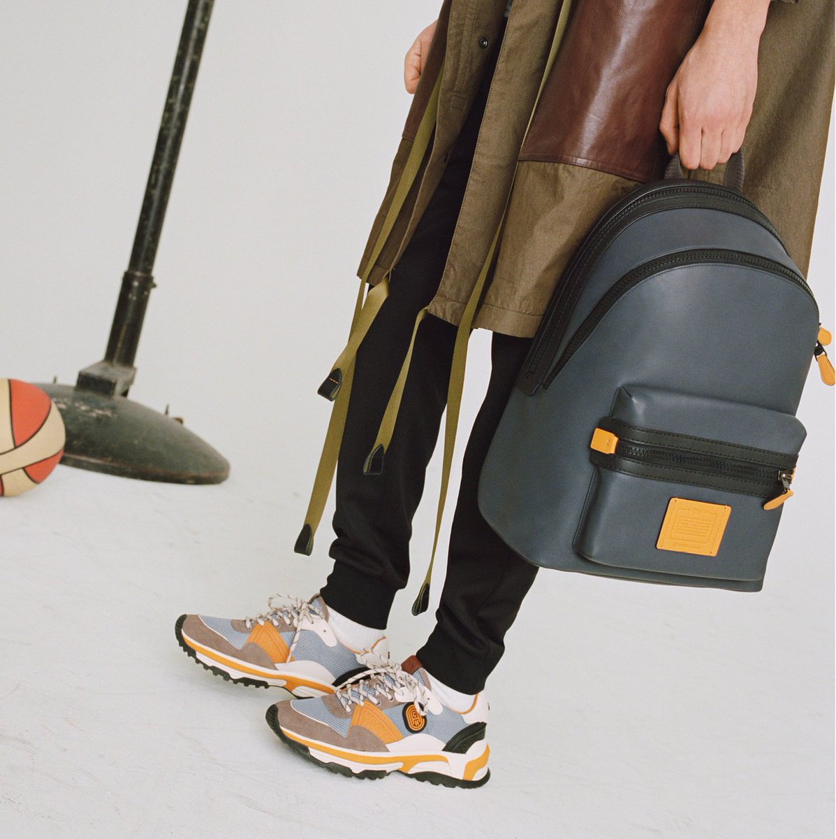 Up the contrast with our colorblocked Academy backpack and C143 Runner — just two ways to punch up basic blues. http://on.coach.com/WeekendShop #CoachNY