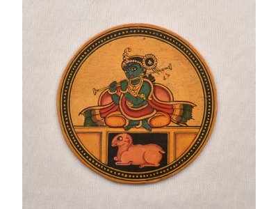 Circular ganjifa or playing card from India, 20th century, painted to depict a seated Lord Krishna with flute, and a ram below his seat. #ganjifa #playingcards