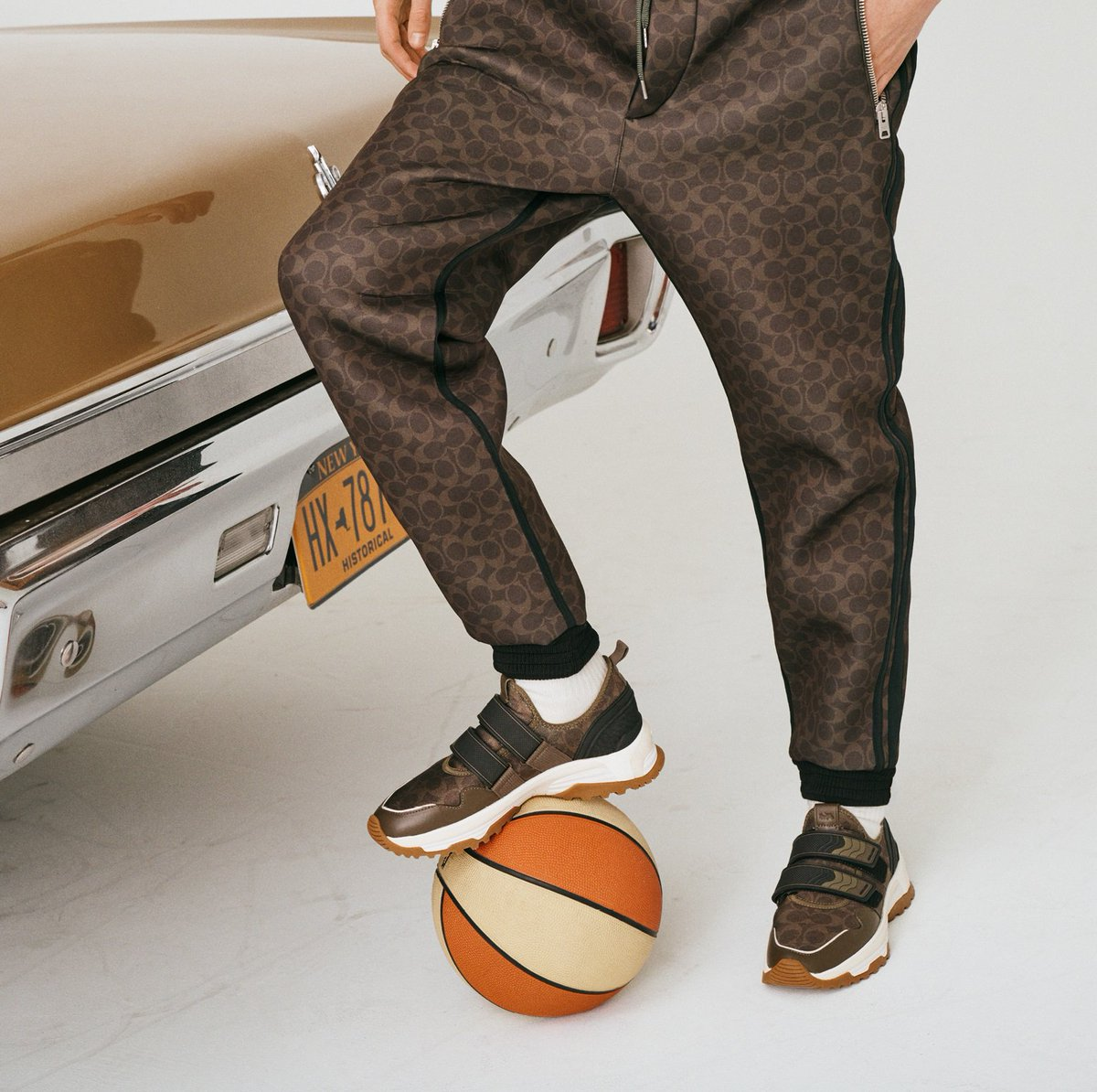 On the ball. Meet our C143 Two Strap Runner—an of-the-moment shape in a chocolatey take on our Signature pattern. http://on.coach.com/C143Runner #CoachNY