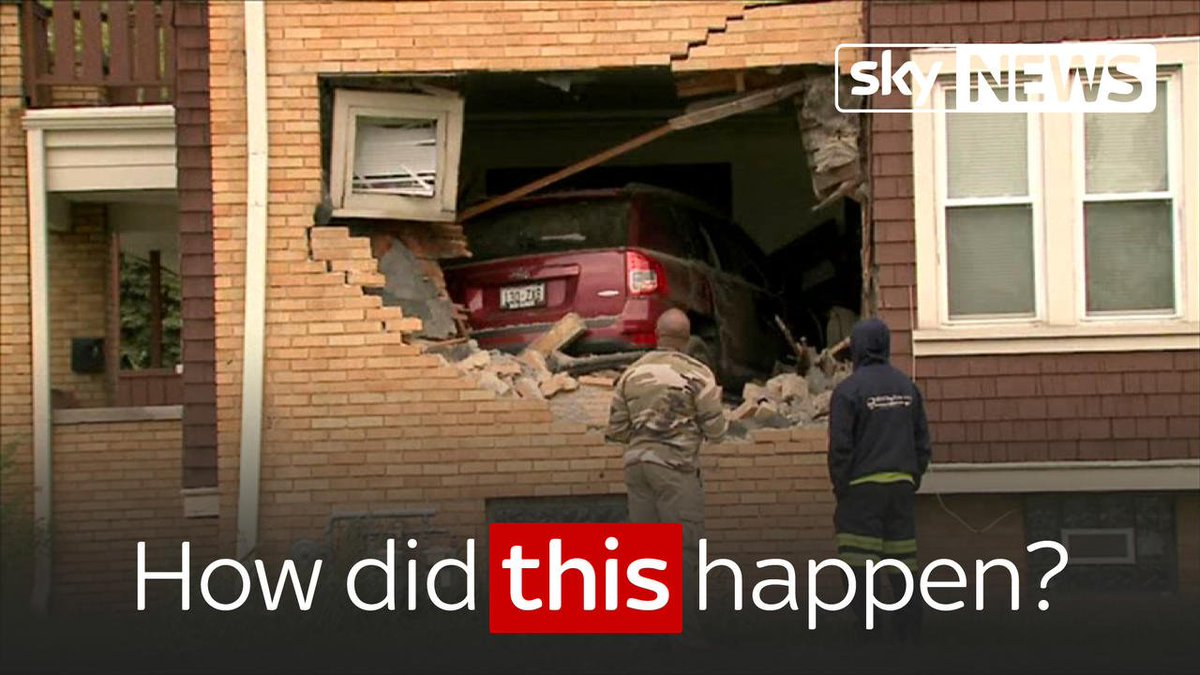 Footage shows a jeep lodged in a house after smashing through the wall... before it reverses out