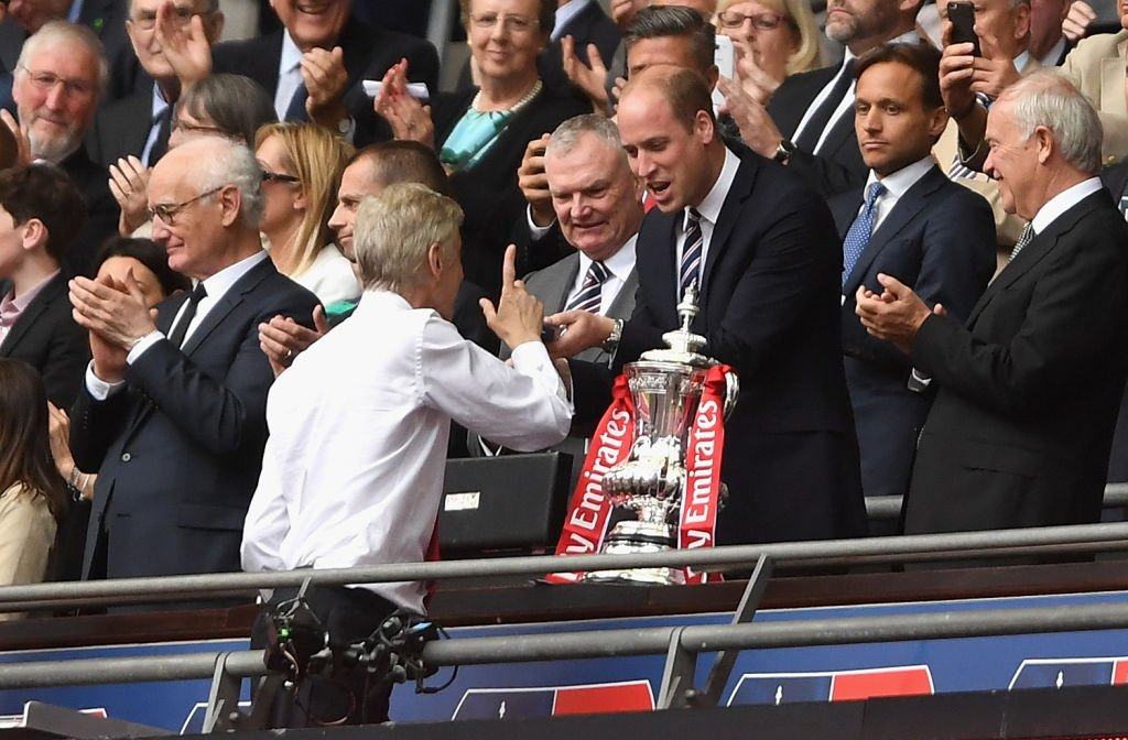Arsene Wenger speaks to Prince William before being handed the FA Cup...