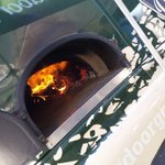 The @OutdoorGourmets wood oven is up to temperature and the first of today's freshly baked pizzas are in! #barnsleyisbrill