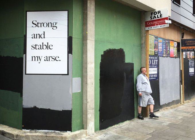 A poster by artist Jeremy Deller, in response to Prime Minister Theresa May, is pasted onto a wall in Camden (Photo: Getty Images)