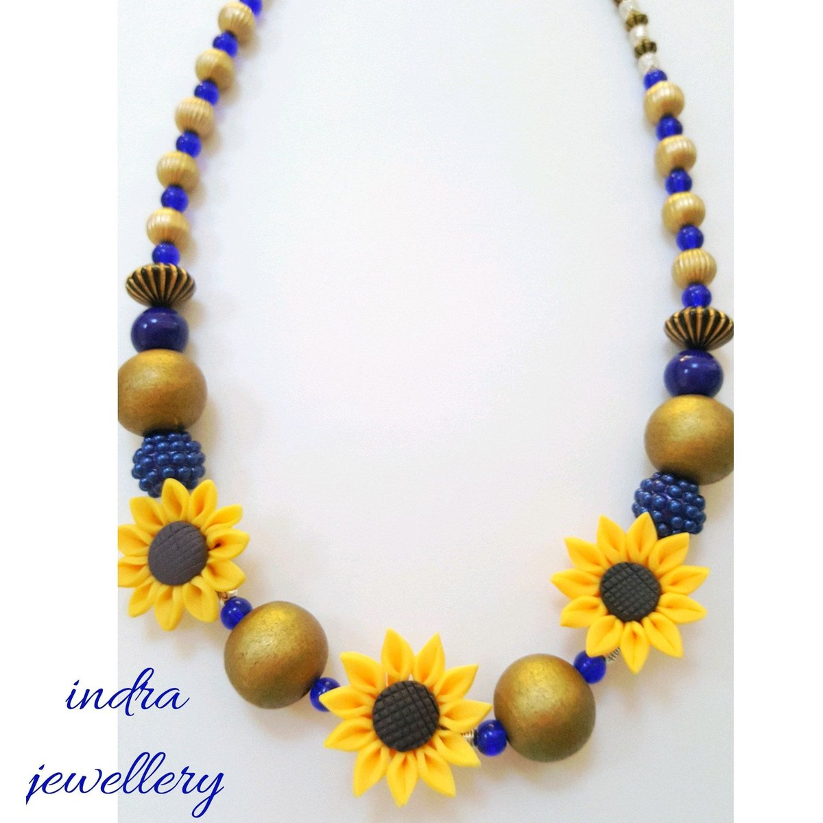This striking #sunflower and colbat blue necklace is the perfect accessory for those summer days!  #handmadehour #ladiescoffeehour<br>http://pic.twitter.com/dWU7Tgb3Xf