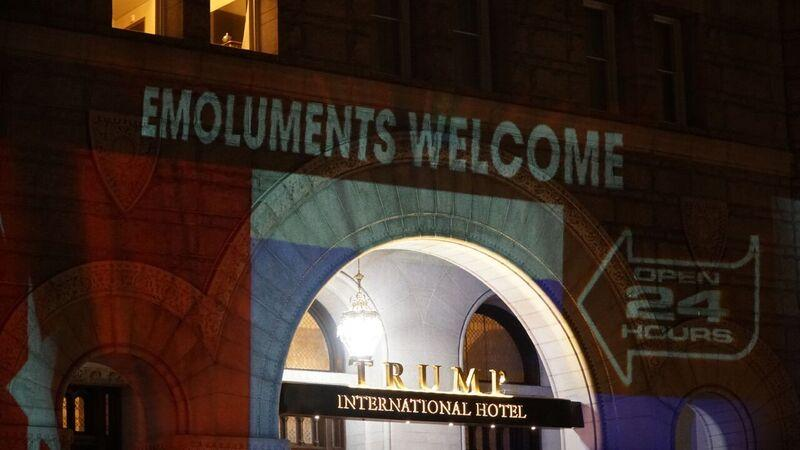 'Pay Trump bribes here' projected onto Trump Hotel entrance https://t.co/KQ9p8Isth7 https://t.co/EpBdNJEJFl