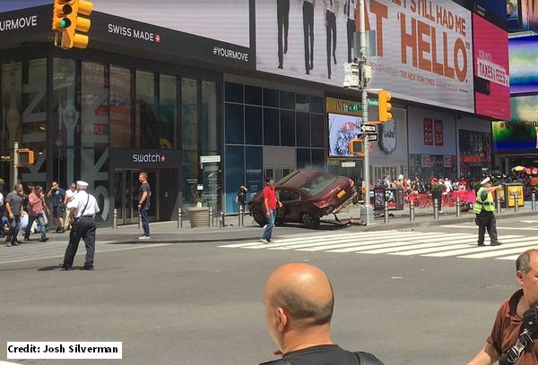Car runs over pedestrians in Times Square, killing at least 1 and injuring 12; no link to terrorism
