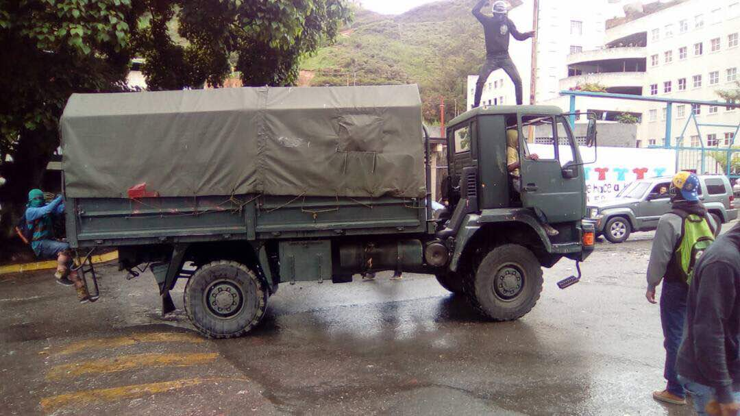 Hooded protesters seized National Guard truck and set it on fire