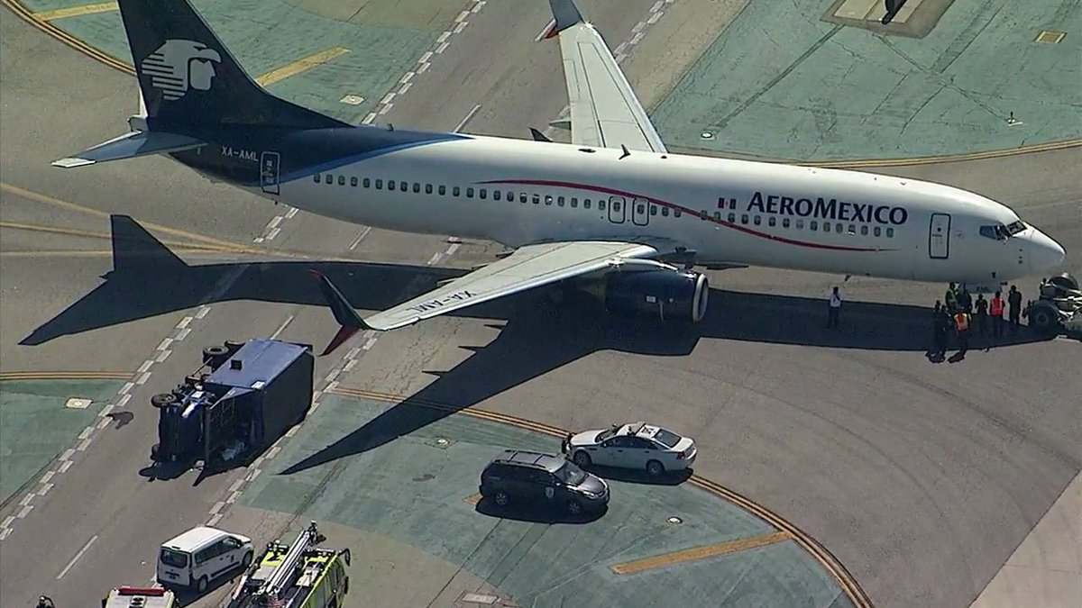 Plane collides with truck at LAX, injuring 8