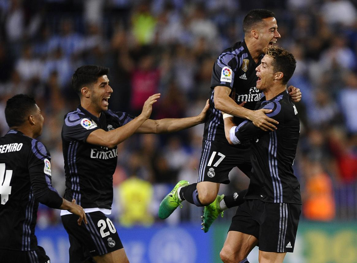 #RealMadrid clinch #LaLiga title after #CristianoRonaldo's heroics against #Malaga   http:// read.ht/BZKm  &nbsp;  <br>http://pic.twitter.com/XlUZSLWIiO