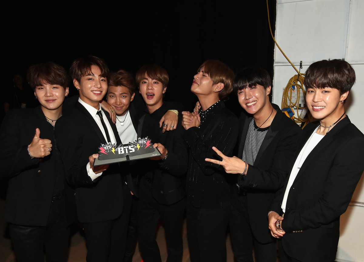 Awwww! Such a sweet moment of @BTS_twt backstage with their #BBMAs Top Social Artist Award!