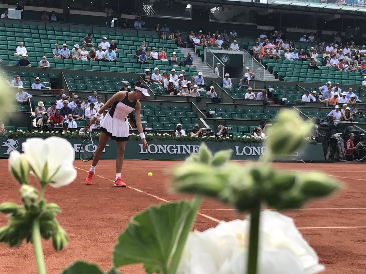 Muguruza in motion.  The defending champion serves out the opening set...