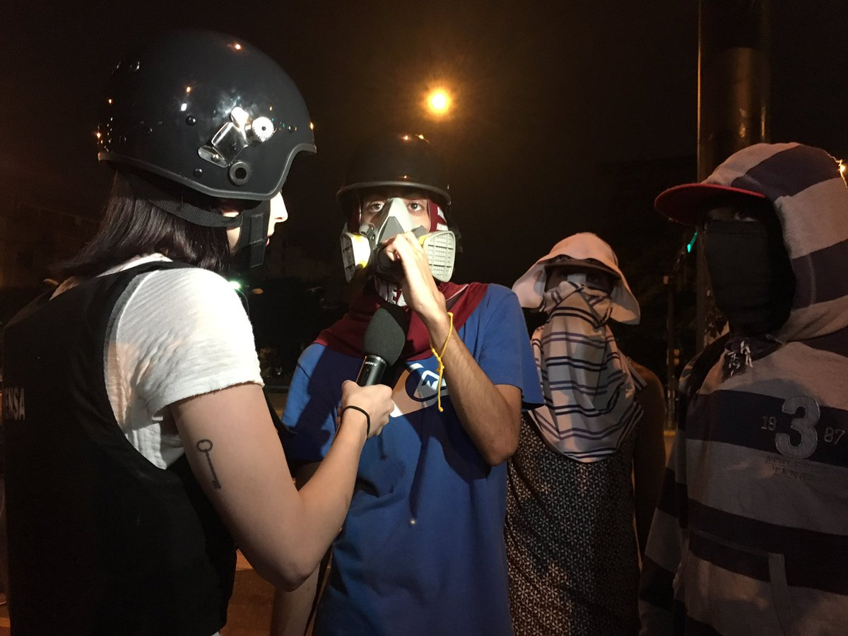 Bringing the story from the front lines in Caracas, Venezuela to talk to opposition protesters