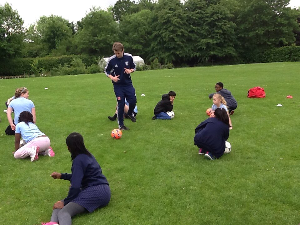 Year5 training with a coach from West Bromwich Albion!!