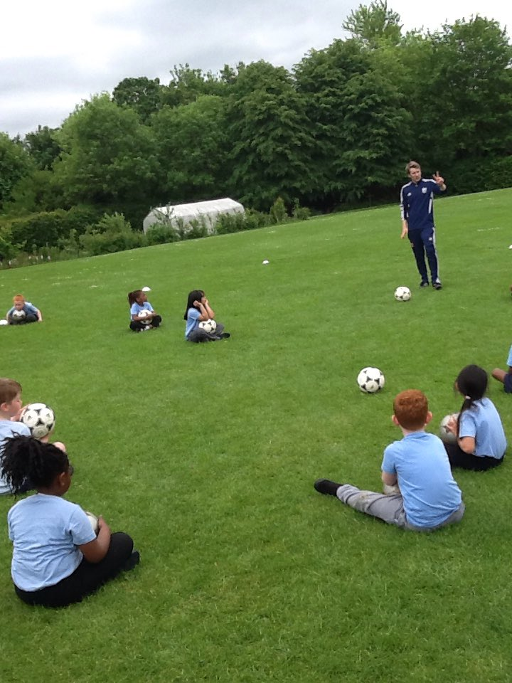 Year One having great fun learning football skills with @WBA
