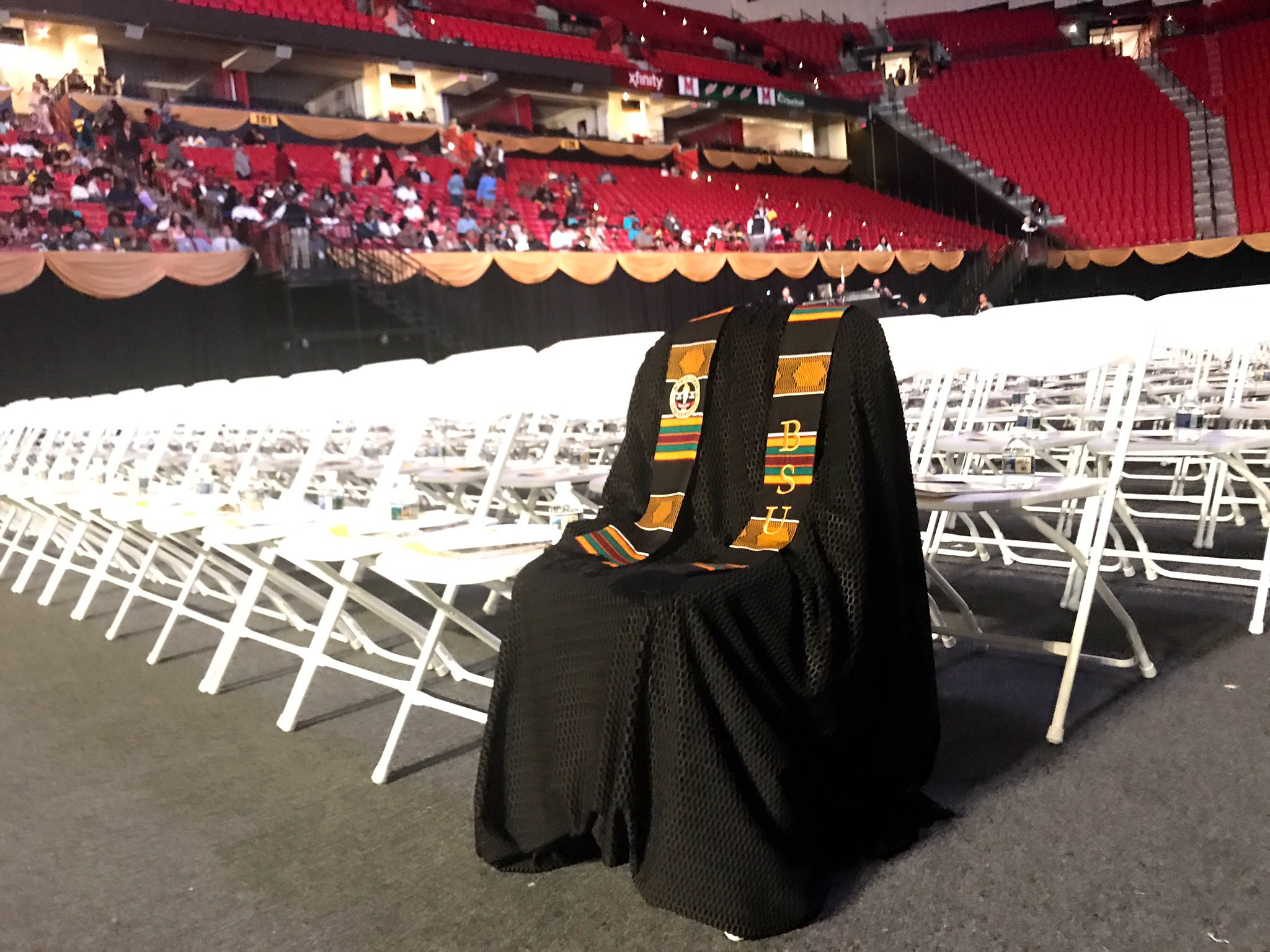 Neal Augenstein‏ at WTOP Radio in Washington, D.C. posted this photo on Twitter: @AugensteinWTOP -- Richard Collins III's graduation gown draped over front row chairs at Bowie State University ceremony. He was murdered Saturday.