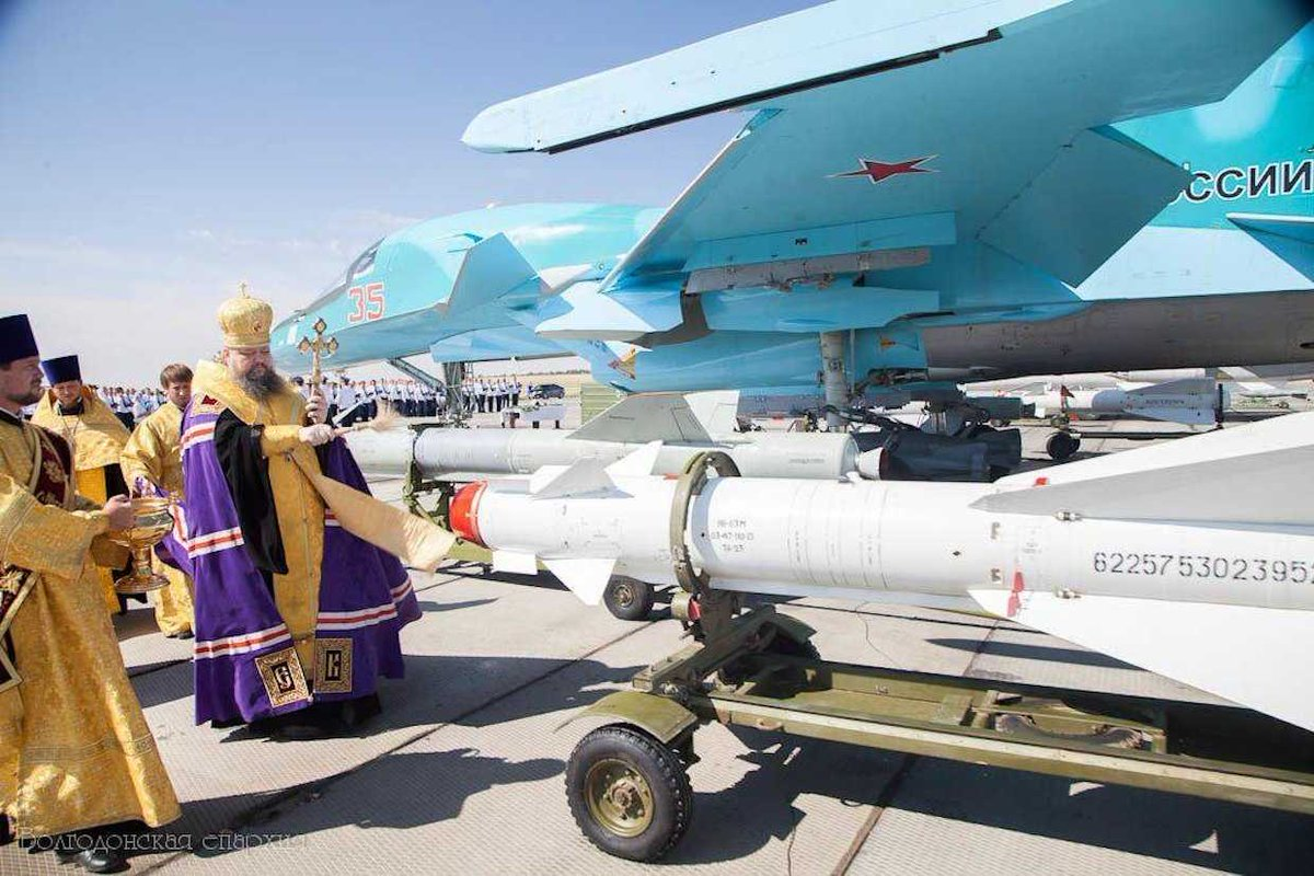 IMAGE: Russian priest blessing missiles to be used in Syria