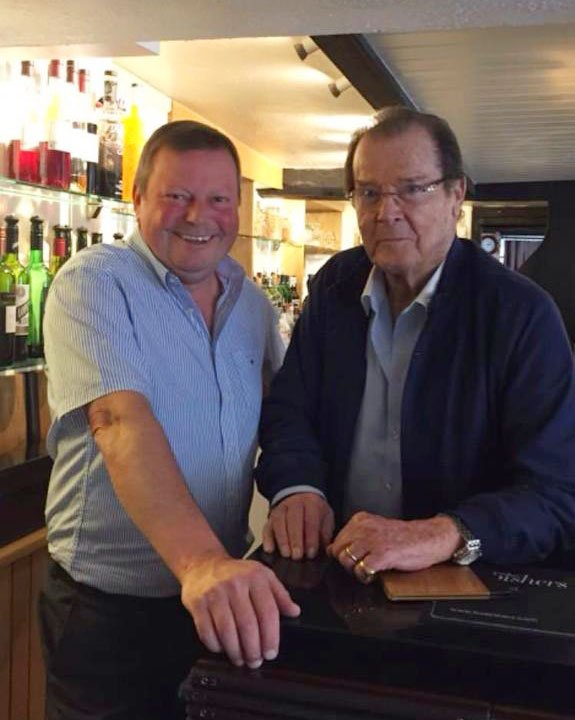 Had the pleasure of serving lunch to @SirRogerMoore not long ago. A charming man who will be greatly missed #ShakenNotStirred #Saint <br>http://pic.twitter.com/qZJZXNsLqA