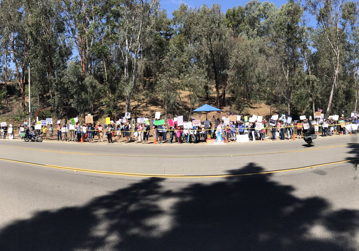 Another Tuesday morning, another crowd of hundreds in front of @DarrellIssa\'s office. #FlipThe49th #DefeatDarrell