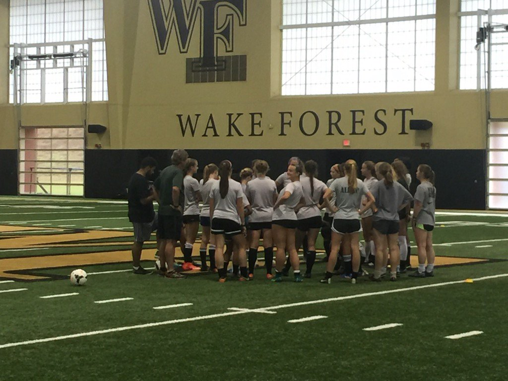 .@WFTitanSoccer getting last min instructions before practice!!.Jacked to see them compete tomorrow!#one #BleedGreen<br>http://pic.twitter.com/4OKqpsATfn
