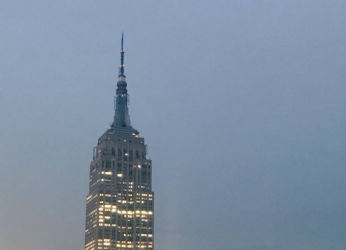 The top of the Empire State Building in New York City will remain dark tonight in honor of the lives lost in the Manchester attack.