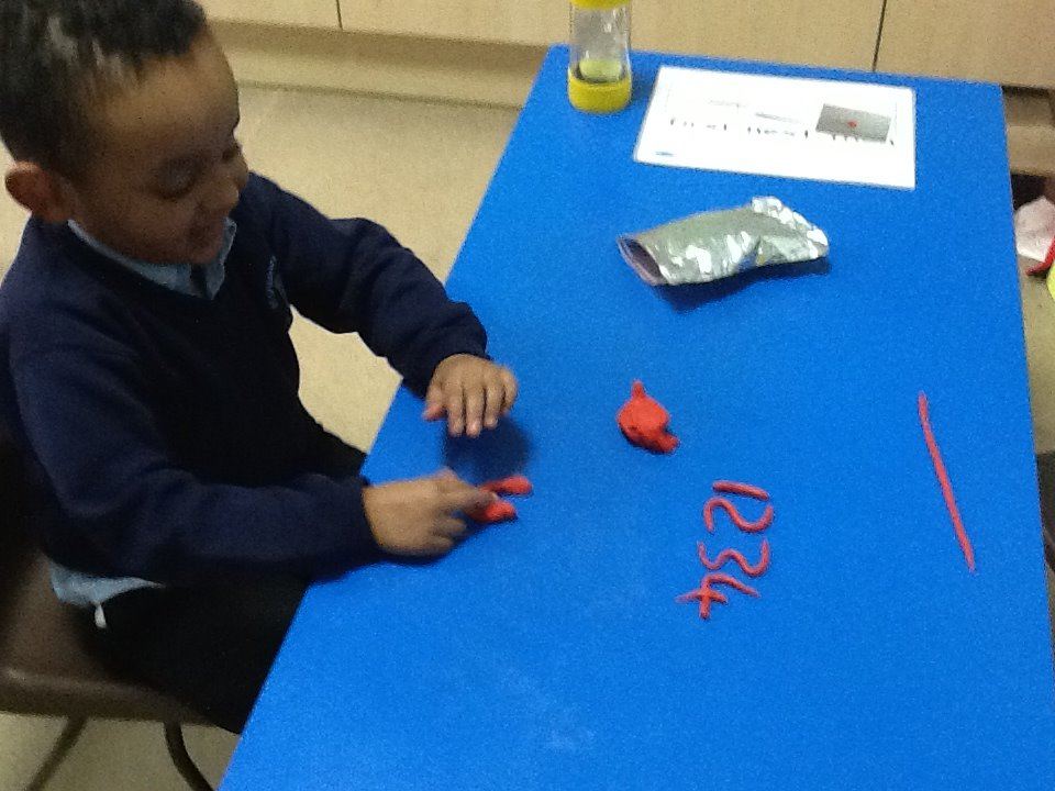 Year One. Making numbers with play dough.