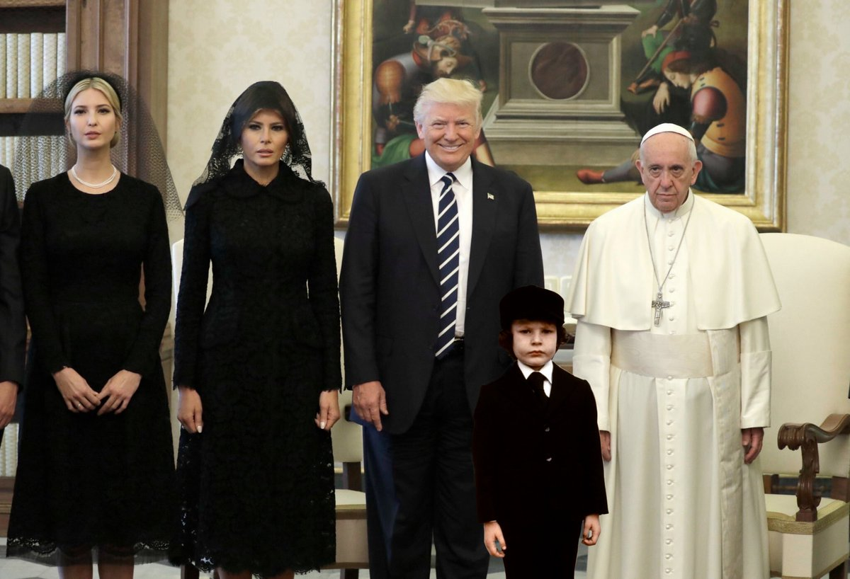 I photoshopped in the kid from THE OMEN and it's so perfect it's unnerving.