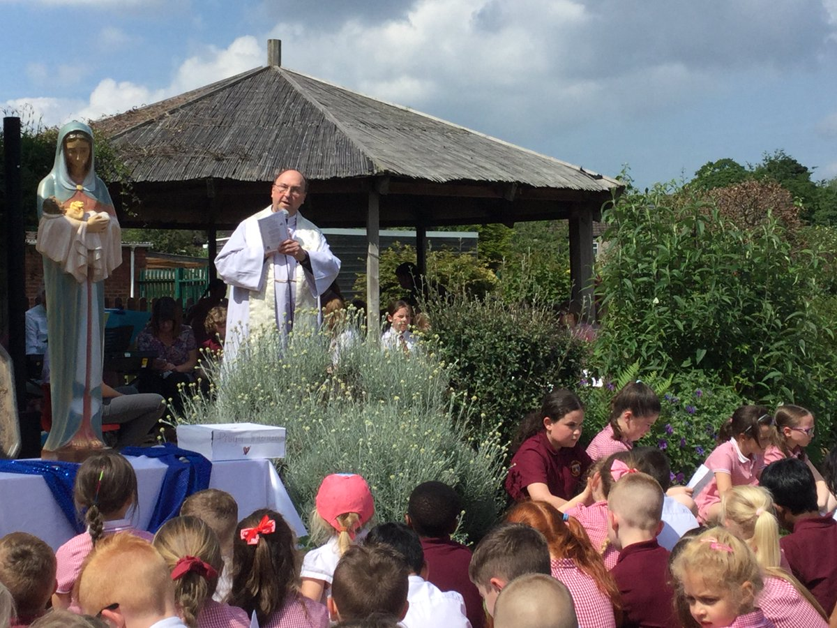 We have had a beautiful afternoon for our May Procession today. Father Bob joined us as we crowned Our Lady in the sunshine.