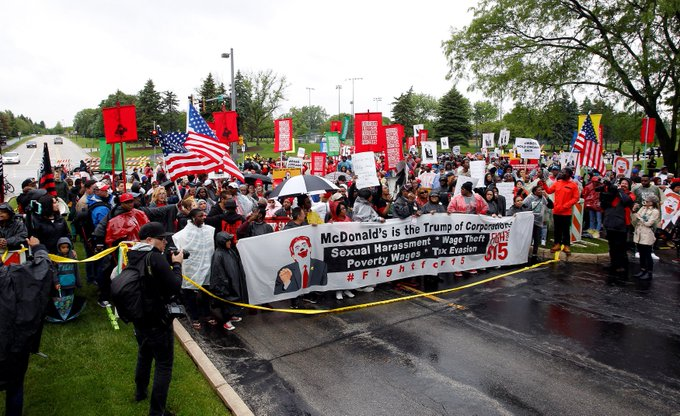 Cooks, cashiers and other McDonald's employees march outside the company's headquarters in Oak Brook, Illinois to #FightFor15.